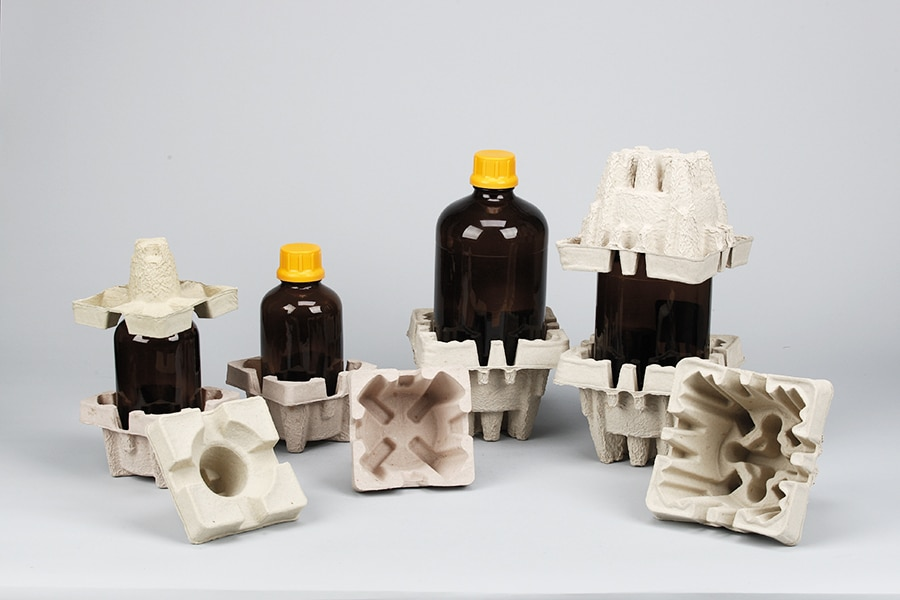 Fiber form for fragile bottles
